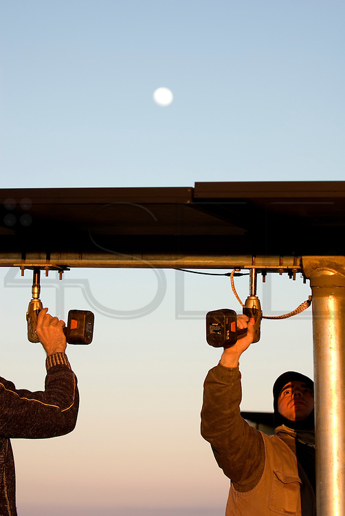 Solar panels fixings are checked and bolts re-tightened.