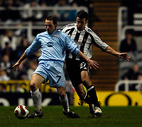 Photo: Jed Wee/Sportsbeat Images.<br /> Newcastle United v Zulte-Waregem. UEFA Cup, 2nd Leg. 22/02/2007.<br /> <br /> Zulte's Tim Matthys (L) holds off Newcastle's Steven Taylor.