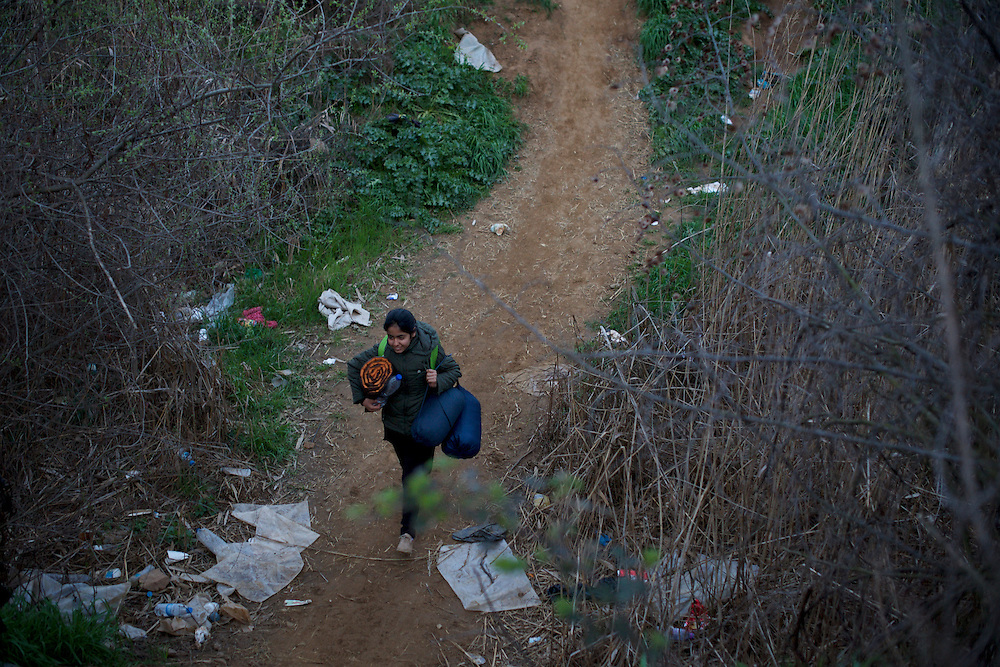 A Syrian child walks through a ditch on her way towards the Greek-Macedonian border station of Idomeni, Greece.