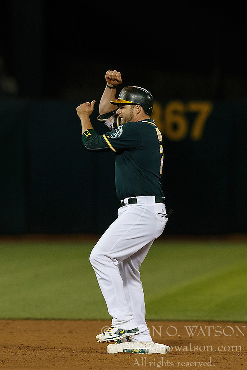 OAKLAND, CA - JULY 19:  Stephen Vogt #21 of the Oakland Athletics celebrates after hitting a double against the Houston Astros during the ninth inning at the Oakland Coliseum on July 19, 2016 in Oakland, California. The Oakland Athletics defeated the Houston Astros 4-3 in 10 innings.  (Photo by Jason O. Watson/Getty Images) *** Local Caption *** Stephen Vogt