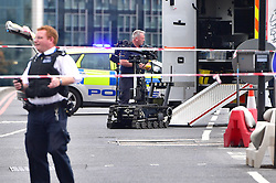 © Licensed to London News Pictures. 28/06/2016. London, UK.  A suspicious car is being inspected by police after it was spotted abandoned on Westminster Bridge. Photo credit: Ben Cawthra/LNP