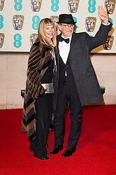 © Licensed to London News Pictures. 14/02/2016. London, UK. KATE CAPSHAW and STEVEN SPIELBERG Steven Spielberg arrive on the red carpet for the EE British Academy Film Awards 2016 after party held at Grosvenor House . London, UK. Photo credit: Ray Tang/LNPPhoto credit: Ray Tang/LNP