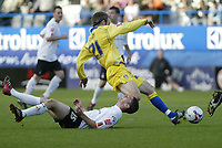 Photo: Marc Atkins.<br />Luton Town v Leeds United. Coca Cola Championship. 21/10/2006. Stephen O'Leary (L) of Luton is flattened by Shaun Derry of Leeds Utd.