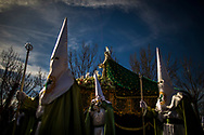 Penitents of the 'Virgen de la Esperanza' brotherhood march as they  take part in a Holy Week procession in Zamora, Spain, Thursday, April 2, 2015. Hundreds of processions take place throughout Spain during the Easter Holy Week.