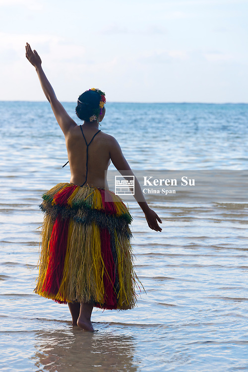 Yapese girl in grass skirt on the beach, Yap Island, Federated States of Micronesia