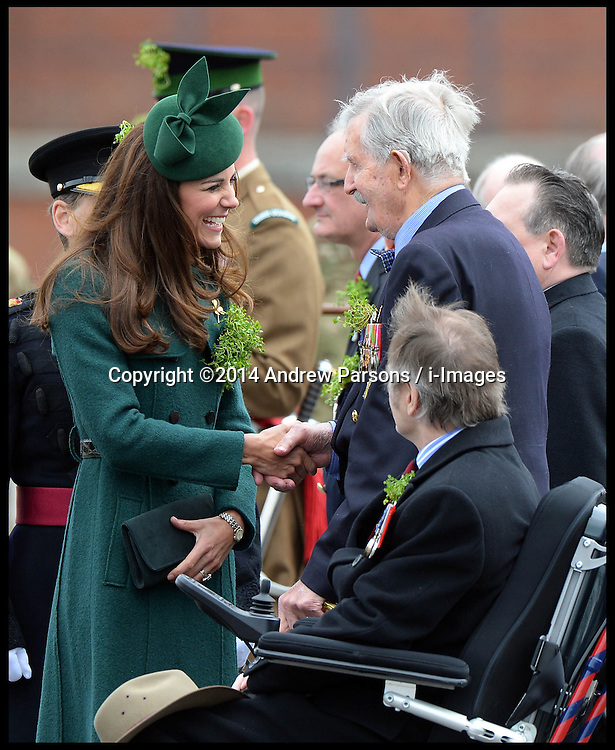 The Duke and Duchess of Cambridge present traditional sprigs of shamrocks to mark St Patrick's day to Officers and Guardsman of the 1st Battalion Irish Guards at Mons Barracks, Aldershot, United Kingdom. Monday, 17th March 2014. Picture by Andrew Parsons / i-Images