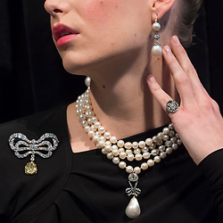 "© Licensed to London News Pictures. 19/10/2018. LONDON, UK. A model wears Marie Antoinette's jewels comprising (L to R) a diamond brooch, second half of the 18th century (Est. USD 50k-80k), a natural pearl and diamond necklace comprising three rows of 116 graduated pearls (Est USD200k-300k), a natural pearl and diamond necklace (Est USD40k-70k), ""Queen Marie Antoinette's Pearl"", a natural pearl and diamond pendant 18th century set (Est USD1m-2m), a pair of natural and pearl diamond pendant earrings, late 18th century (Est USD200k-300k) and a monogrammed ring containing a lock of the queen's hair (Est. USD8k-10k).  Preview of Sotheby's ""Royal Jewels from the Bourbon-Parma Family"", a family descended from Louis XIV of France, the Holy Roman Emperors and from Pope Paul III, with links to the most important ruling families of Europe. Led by a breath-taking group of jewels which once belonged to Marie Antoinette, queen of France, the collection of jewels will be offered for sale at Sotheby's in Geneva on 14 November 2018.  Photo credit: Stephen Chung/LNP"