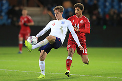 England U21's Kieran Dowell (left) and Denmark U21's Alexander Bah battle for the ball during the international friendly match at the Blue Water Arena, Esbjerg.