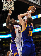 Feb. 10, 2011; Phoenix, AZ, USA; Golden State Warriors forward David Lee (10) is blocked by Phoenix Suns guard Mickael Pietrus (12) at the US Airways Center. Mandatory Credit: Jennifer Stewart-US PRESSWIRE