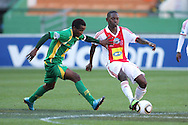 CAPE TOWN, SOUTH AFRICA - 28 MARCH 2010, Diphetogo Dipsy Selolwane of Ajax Cape Town attempts to get his pass away before Joseph Musonda of Golden Arrows during the Telkom Knock Out match between Ajax Cape Town and Golden Arrows held at Newlands Stadium in Cape Town, South Africa..Photo by: Shaun Roy/Sportzpics