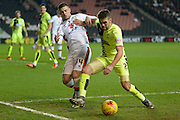 MK Dons forward Jake Forster-Caskey battles Huddersfield Town defender Tommy Smith during the Sky Bet Championship match between Milton Keynes Dons and Huddersfield Town at stadium:mk, Milton Keynes, England on 23 February 2016. Photo by Dennis Goodwin.