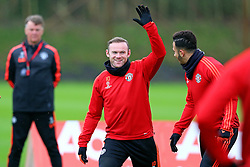 Wayne Rooney of Manchester United jokes with Memphis Depay of Manchester United under the watchful eye of Louis van Gaal - Mandatory byline: Matt McNulty/JMP - 07966386802 - 24/11/2015 - FOOTBALL - Aon Training Complex -Manchester,England - UEFA Champions League