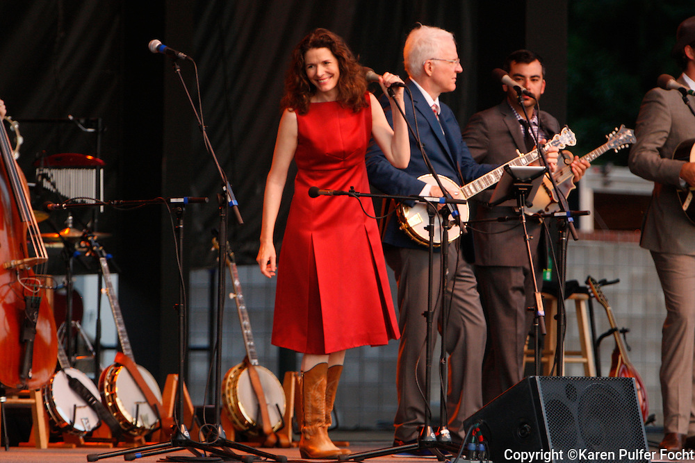 "August 2, 2013 - Comedian Steve Martin, performed at Snowden Grove Amphitheater, Saturday evening, in his more current role as a blue grass musician. He is touring with the North Carolina bluegrass band the Steep Canyon Rangers and singer-musician Edie Brickell (left). He did use every opportunity to still get a laugh, while performing with his banjo. The Martin-Brickell the pair has collaborated on a musical together. ""Bright Star,"" based on an original story by the two set in the Blue Ridge Mountains in the early 20th century, will have its world premiere September 13 at the Old Globe Theater in San Diego, California."