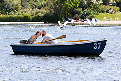 © Licensed to London News Pictures. 22/08/2019. London, UK. A couple in a pedal boat in Serpentine's boating lake in Hyde Park on a warm and sunny day in London. According to the Met Office, the temperatures are forecast to increase to 30 degrees celsius over the bank holiday weekend. Photo credit: Dinendra Haria/LNP