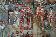 Fresco of the Annunciation, the Visitation and the Proof of the Virgin, in Cavusin Church, built 964-65, at Cavusin, a village between Avanos and Goreme, in Goreme National Park, Nevsehir province, Cappadocia, Central Anatolia, Turkey. The church is cut into the soft volcanic tuff created by ash from volcanic eruptions millions of years ago. This area forms part of the Goreme National Park and the Rock Sites of Cappadocia UNESCO World Heritage Site. Picture by Manuel Cohen