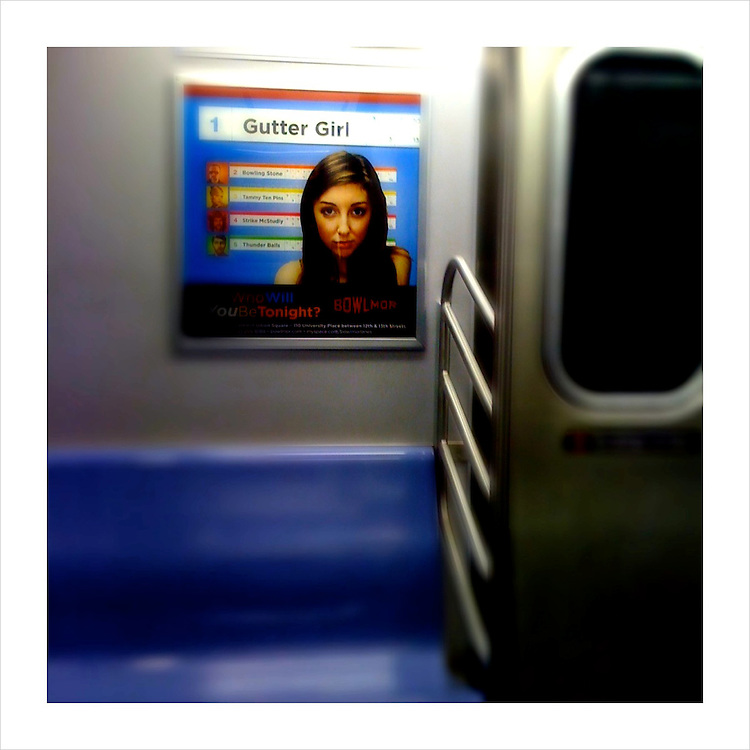 A poster on a NYC Subway train. (iPhone image)