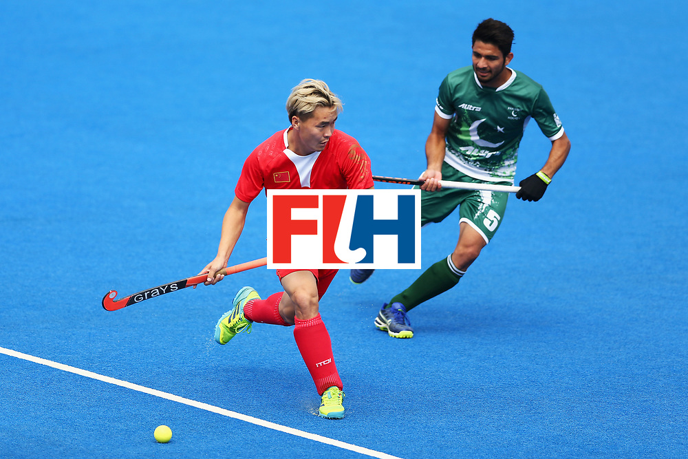 LONDON, ENGLAND - JUNE 25: Xiaoping Guo of China attempts to get past Abu Mahmood of Pakistan during the 7th/8th place match between Pakistan and China on day nine of the Hero Hockey World League Semi-Final at Lee Valley Hockey and Tennis Centre on June 25, 2017 in London, England.  (Photo by Steve Bardens/Getty Images)