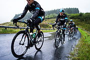 Hermitage, Hawick, Scottish Borders, UK,15th September 2013. Determination on the face of Sir Bradley Wiggins as the peloton braved gale force winds and heavy rain on the opening stage of the Tour of Britain.