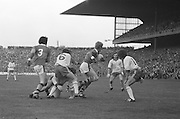 Tyrone forwards putting pressure on the Kerry backs as they try to score during the All Ireland Minor Gaelic Football Final, Tyrone v Kerry in Croke Park on the 28th September 1975.
