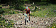 SHOT 8/19/11 8:54:00 AM - Colin Cares of Boulder, Co. descends a rocky section of trail during the final day of racing in The Breck Epic in Breckenridge, Co. Cares finished in fifth place in the Solo Open Men's category with an overall time of 19:28:38. The event is a 6-day ultra-endurance mountain bike stage race held in the sprawling backcountry surrounding the town of Breckenridge, Co. The course is 240 miles and features a combined 38,000 feet of climbing, 90% of which is above 10,000 feet. More than 200 riders from 15 different countries participated in the race. (Photo by Marc Piscotty / © 2011)
