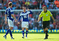 BIRMINGHAM, ENGLAND - Sunday, September 12, 2010: Birmingham City's Barry Ferguson screams at referee Mark Halsey to book a Liverpool player during the Premiership match at St Andrews. (Photo by David Rawcliffe/Propaganda)