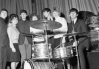 The Beatles posing for photographs with fans before their show at the Adelphi Theatre in Dublin in 1963.<br />