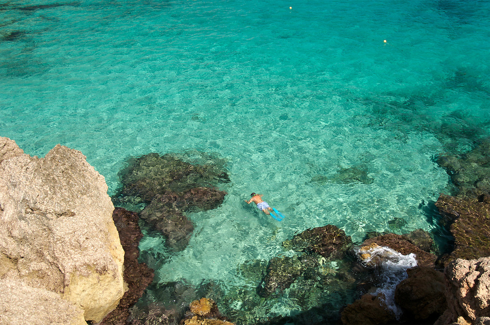A lone swimmer in Majorca