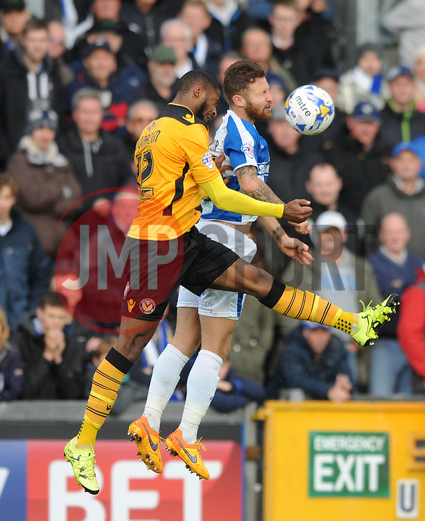 Matt Taylor of Bristol Rovers challenges for the header with Janoi Donacien of Newport County - Mandatory byline: Dougie Allward/JMP - 07966 386802 - 24/10/2015 - FOOTBALL - Memorial Stadium - Bristol, England - Bristol Rovers v Newport County AFC - Sky Bet League Two