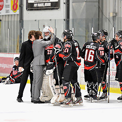"""FORT FRANCES, ON - May 2, 2015 : Central Canadian Junior """"A"""" Championship, game action between the Fort Frances Lakers and the Soo Thunderbirds, Championship game of the Dudley Hewitt Cup. Injured goaltender Nathan Park #78 speaks to Pierce Dushenko #28 after the game.<br /> (Photo by Shawn Muir / OJHL Images)"""