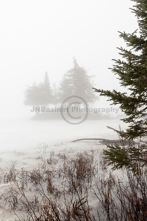 An early thaw, creates thick, heavy fog over Heaney Lake in Quebec, Canada