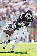 STARKVILLE, MS - SEPTEMBER 19:  De'Runnya Wilson #1 of the Mississippi State Bulldogs runs the ball and is hit by Lyn Clark #5 of the Northwestern State Demons at Davis Wade Stadium on September 19, 2015 in Starkville, Mississippi.  The Bulldogs defeated the Demons 62-13.  (Photo by Wesley Hitt/Getty Images) *** Local Caption *** De'Runnya Wilson; Lyn Clark