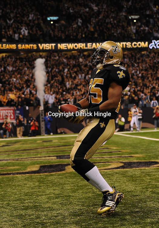 16 January 2010: New Orleans Saints running back Reggie Bush (25) celebrates in the endzone following a touchdown run during a 45-14 win by the New Orleans Saints over the Arizona Cardinals in a 2010 NFC Divisional Playoff game at the Louisiana Superdome in New Orleans, Louisiana.