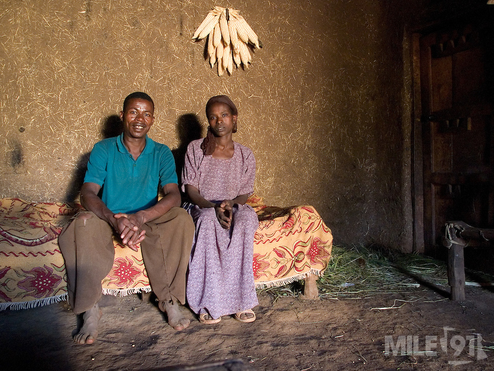 Banga Bera, 40 and his wife Elfnesh Finta, 35 in their home in Boreda, Ethiopia. On the wall behind them is maize they have saved for replanting.