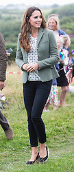 Kate makes first public appearance since birth of baby George as she helps Prince William start the Ring o'Fire Ultra Marathon, Anglesey, United Kingdom. Friday, 30th August 2013. Picture by i-Images