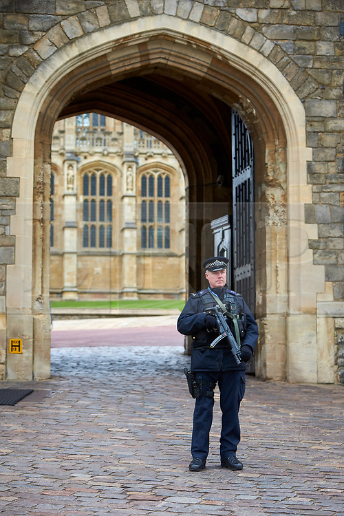 © Licensed to London News Pictures. 29/03/2017. WINDSOR, UK.  The Changing of the Guard cerenomy takes places at Windsor Castle amid heightened security. Heavy barriers have been installed along the parade route and armed police officers are present.   Photo credit: Cliff Hide/LNP