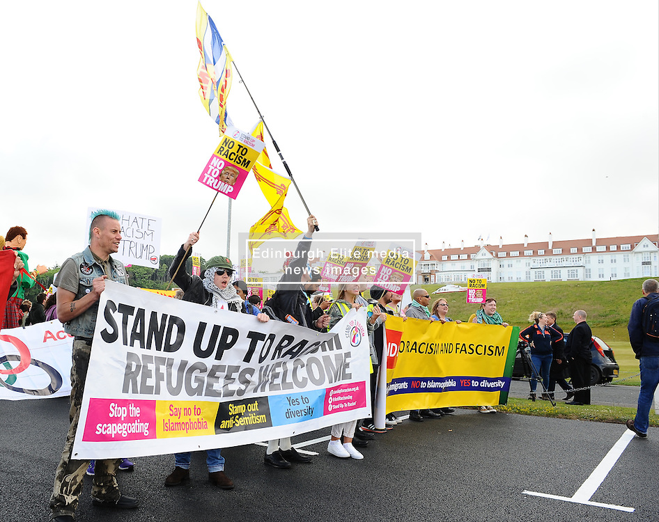 Pictured: Protesters gather to protest against US Presidential candidate Donald Trump as he arrives in Scotland to open his multi-million pound redevelopment of his Turnberry hotel and golf resort.<br /> <br /> <br /> © Dave Johnston/ EEm