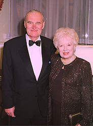 MR TIM AITCHISON and his wife actress JUNE WHITFIELD, at a ball in London on 29th January 1998.MEY 8