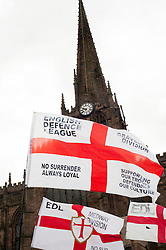 EDL members and supporters flags in All Saints Square near Rotherham Minster during Saturdays  EDL rally in South Yorkshire  in Rotherham Town Centre <br /> <br /> May 10 2014<br /> Image © Paul David Drabble <br /> www.pauldaviddrabble.co.uk