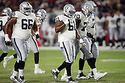 Oakland Raiders guard Gabe Jackson (66), Oakland Raiders center Rodney Hudson (61), Oakland Raiders offensive tackle Kelechi Osemele (70) and a fourth offensive lineman walk to the line of scrimmage during the 2016 NFL preseason football game against the Arizona Cardinals on Friday, Aug. 12, 2016 in Glendale, Ariz. The Raiders won the game 31-10. (©Paul Anthony Spinelli)