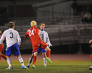 Oxford High's Ty Barber (7) vs. Lafayette High's Michael Hudgins (24) in boys high school soccer action at Bobby Holcomb Field in Oxford, Miss. on Monday, December 10, 2012. Oxford won 8-0.