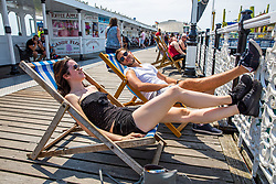 © Licensed to London News Pictures. 01/07/2016. Brighton, UK. Members of the public take the beach in Brighton and Hove as sunny and hot weather continues to hit the seaside resort. Photo credit: Hugo Michiels/LNP