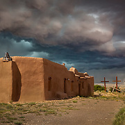Last light on the Penitente Morada before the lightning and brewing storm closed in on Abiqui, New Mexico