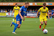 AFC Wimbledon midfielder Scott Wagstaff (7) dribbling into box during the EFL Sky Bet League 1 match between AFC Wimbledon and Wycombe Wanderers at the Cherry Red Records Stadium, Kingston, England on 31 August 2019.