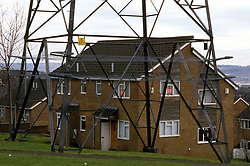 Electricity pylon & housing estate; Newburn; Newcastle-upon-Tyne; UK