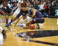 """Ole Miss' Anthony Perez (13) and Auburn guard Brian Greene Jr. (24) vie for a loose ball at the C.M. """"Tad"""" Smith Coliseum on Saturday, February 23, 2013.  (AP Photo/Oxford Eagle, Bruce Newman)"""