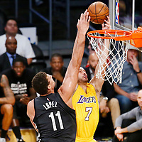 15 November 2016: Los Angeles Lakers forward Larry Nance Jr. (7) goes for the dunk over Brooklyn Nets center Brook Lopez (11) during the LA Lakers 125-118 victory over the Brooklyn Nets, at the Staples Center, Los Angeles, California, USA.