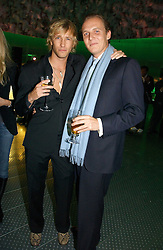 Left to right, RICK PARFITT jnr and GEORGE CADBURY at a party to celebrate the launch of Pilsner Urquell beer held in the Pavillion at The Serpentine Gallery, London on 4th October 2006.<br />