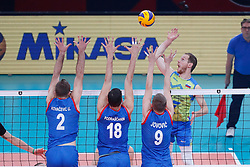 PARIS, FRANCE - SEPTEMBER 29: Tine Urnaut #17 of Slovenia spikes the ball against Uros Kovacevic #2, Marko Podrascanin #18 and Nikola Jovovic #9 of Serbia during the EuroVolley 2019 Final match between Serbia and Slovenia at AccorHotels Arena on September 29, 2019 in Paris, France.  Photo by Catherine Steenkeste / Sipa / Sportida