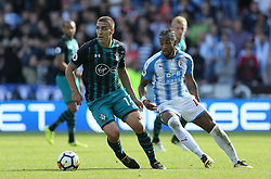 Southampton's Oriol Romeu (left) and Huddersfield Town's Kasey Palmer in action during the Premier League match at the John Smith's Stadium, Huddersfield.