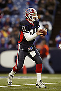 Bills quarterback Drew Bledsoe looks downfield during a 20 to 3 win by the Miami Dolphins over the Buffalo Bills in an NFL Week 16 game in Buffalo on December 21, 2003. Drew was sacked six times while completing only 12 of 24 passes with one interception and no touchdowns. ©Paul Anthony Spinelli